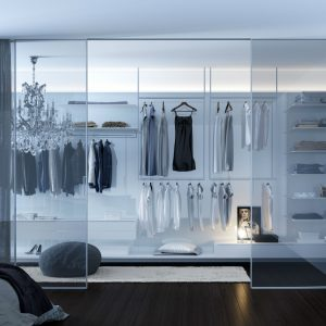 clear sliding doors leading to large walk in wardrobes