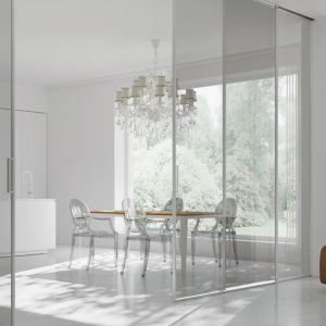 glass sliding doors leading to dining room and kitchen