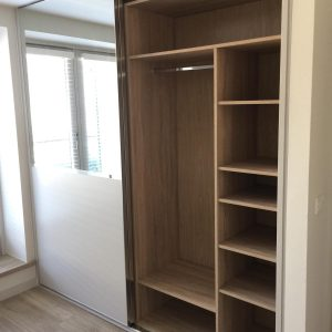 mirrored wardrobe with lots of shelves and storage inside