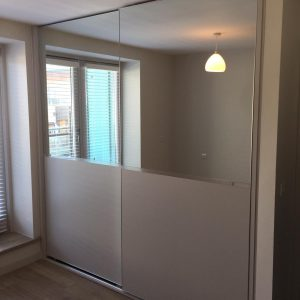 fitted wardrobe with mirrored section
