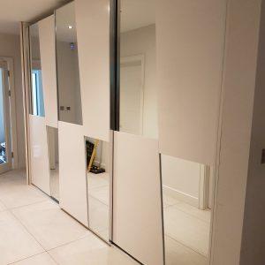 white and mirrored wardrobe