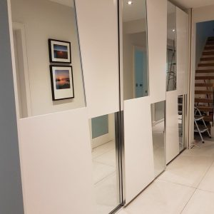 large sliding wardrobe with glass partitions