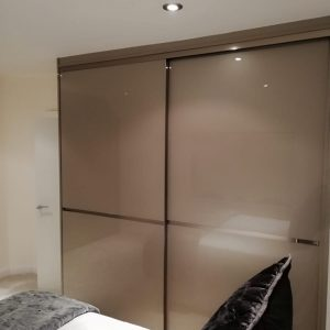 large brown sliding wardrobe in bedroom