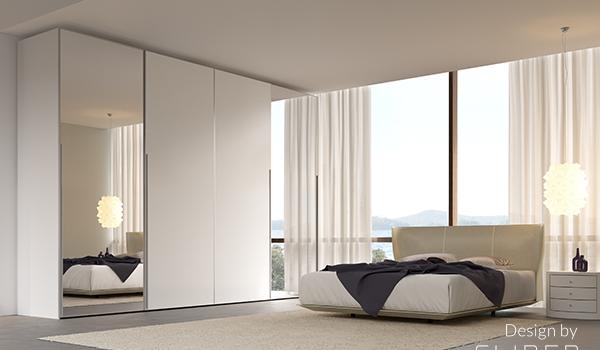 sliding wardrobe door in cream bedroom
